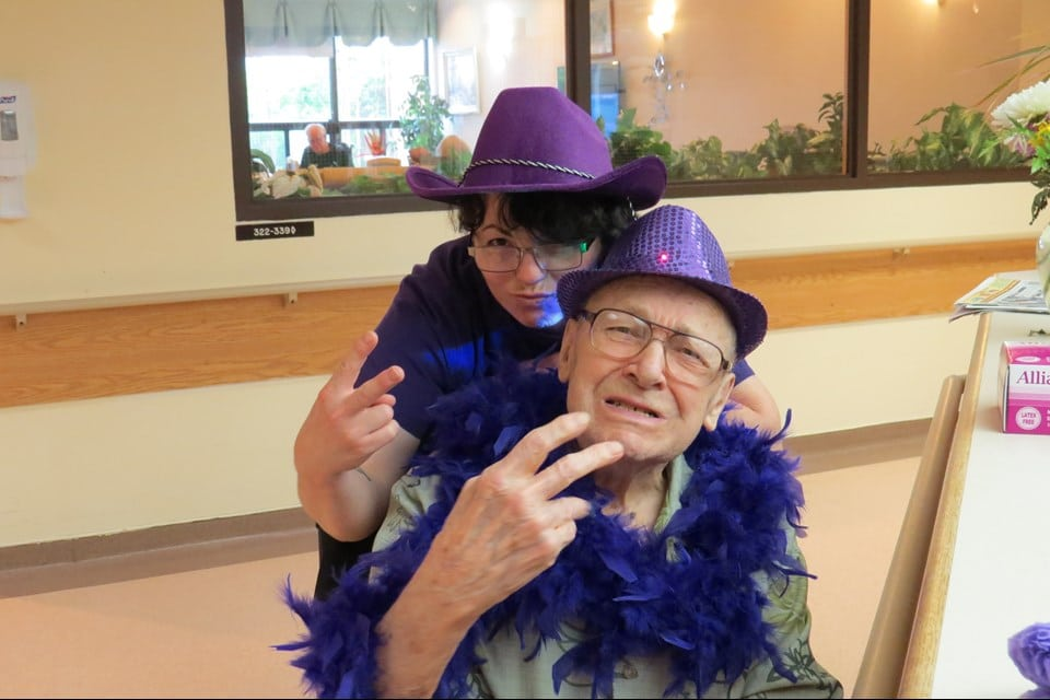 Photo of personal support worker Dannielle Planes and resident Mr. Merredew